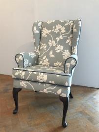 Vintage winged arm chair