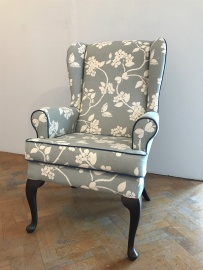 Vintage winged arm chair